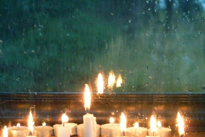 candles in rainy window